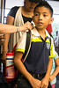 3rd grader Richard Rendon receives a tag as he checks in for school on the first day at Northaven Elementary. 7/28/16