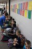 Northaven students line the wall as they await classroom assignments on opening day of school. 7/28/16