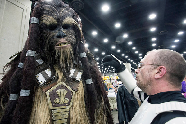 Stormtrooper Eric Antic helps Wookiee Mark Gau get adjusted while walking the floor of FandomFest 2016. 7/30/16