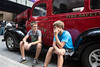 Nate and Landan Raleigh sit on the running board of their grandfather's 1946 Chevy Suburban during a Fourth Street Live visit on Wednesday afternoon. 8/3/16