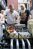 Roscoe Willett looks over the engine of Chris Dillander's 1931 Ford Roadster at Fourth Street Live on Wednesday during a National Street Rod Association parade of vintage cars. 8/3/16