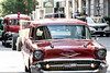 David Alvey drives his '57 Chevy into Fourth Street Live as part of the National Street Rod Association's annual parade. 8/3/16