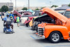 Spectators peruse the 11,000+ vintage vehicles during the National Street Rods show at the Expo Center on Saturday. 8/6/16