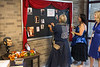 Staff at Lincoln Elementary decorate a bulletin board with images from the tacky prom held to welcome back teachers and staff on Monday morning. 8/8/16