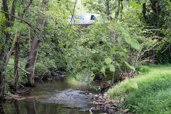 A work van travels over a creek along KY-22 where repairs will soon begin to add support for heavier commercial vehicles and school busses. 8/8/16