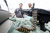 Jonathan Detch and Evan Wray check out a vintage M60 machine gun during the Spirit of '45 Commemoration at Bowman Field. 8/13/16