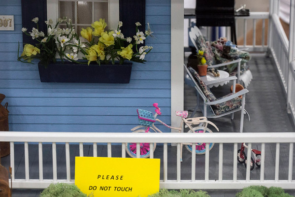 A miniature bicycle sits on the front porch of Debra Beard's award winning dollhouse at the Kentucky State Fair. 8/24/16