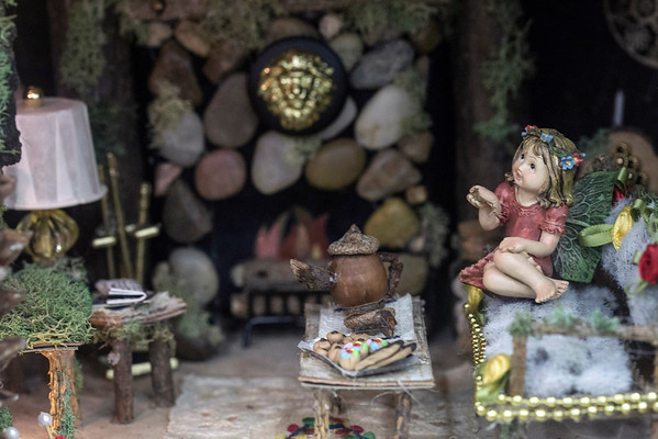 A fairy sits near the hearth inside a multi-tiered dollhouse designed by Judy Scott at the Kentucky State Fair. 8/24/16