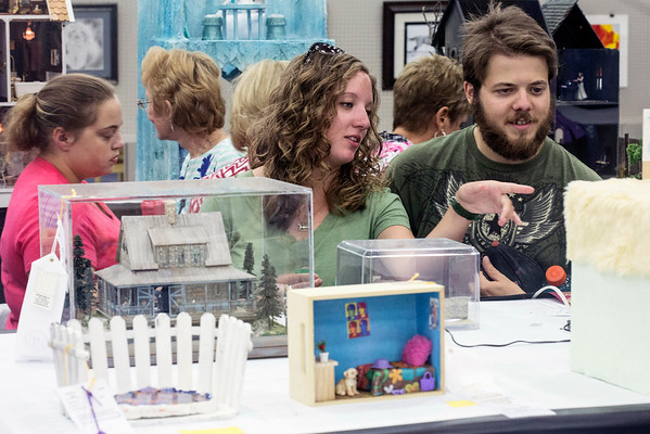Kelly Bloomfield and Christopher Payton check out the details in the dollhouse exhibit at the Kentucky State Fair. 8/24/16
