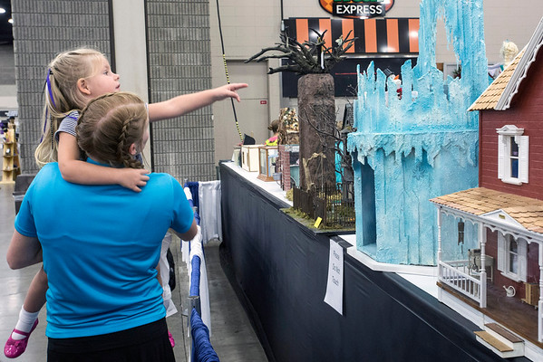 Baylee Jensen and Ellie McCoy of Radcliff, KY check out a Frozen-inspired entry in the dollhouse exhibit at the Kentucky State Fair on Wednesday afternoon. 8/24/16