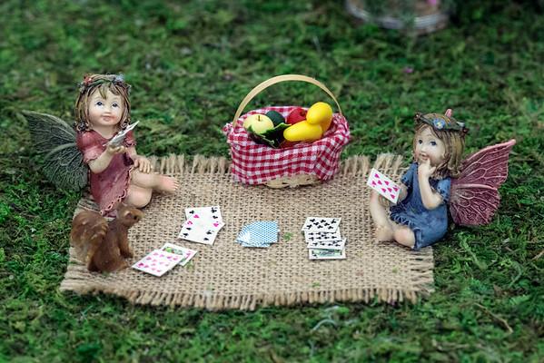 Fairies play cards on the grass of Fairyville; an award winning dollhouse entry by Judy Scott at the Kentucky State Fair. 8/24/16