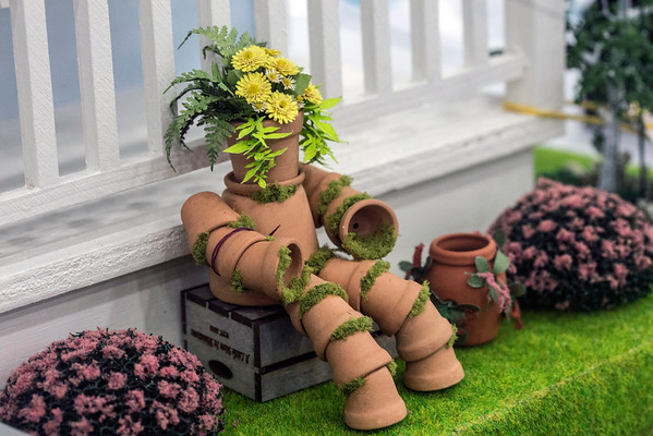 A pot monster sits near the porch of Kathleen Cable's award-winning dollhouse at the Kentucky State Fair. 8/24/16