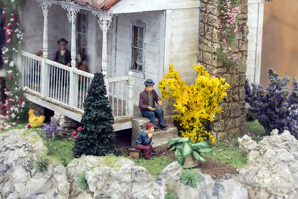 Babette Overman's blue ribbon winning country themed dollhouse took top honors in the class 043 small scale scene or structure category at the Kentucky State Fair. 8/24/16