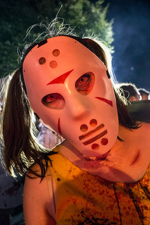 A masked zombie known only as Megan makes sure the camera sees her during the annual Zombie Walk in the Highlands on Saturday. 8/27/16