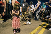 Miniature zombie Sadie Hall drags a baby behind her as a row of photographers seize the opportunity. 8/27/16