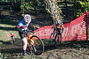 Cyclists struggle on a steep incline that forces some to dismount during the 12th Annual Papa John's Storm Eva Bandman Halloween Cross. 10/23/16
