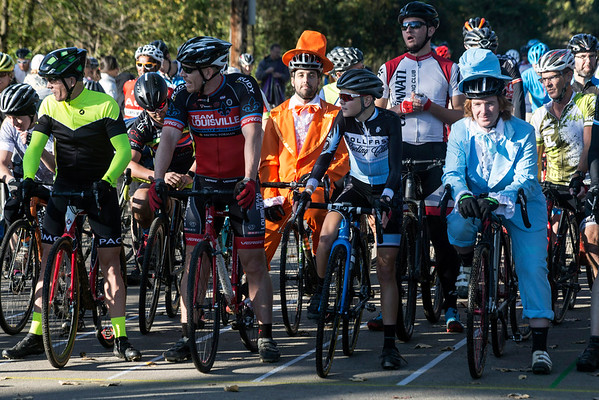 Cyclists Richard Kelly (orange tuxedo) and Peter Reid (blue tuxedo) were costumed for the12th Annual Papa John's Storm Eva Bandman Halloween Cross on Sunday morning. 10/23/16
