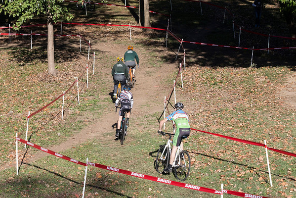 Cyclists navigate a treacherous terrain over hills and through woods during the 12th Annual Papa John's Storm Eva Bandman Halloween Cross. 10/22/16