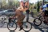 Cyclist Gregg Dyas dons a T-rex costume during the 12th Annual Papa John's Storm Eva Bandman Halloween Cross on Sunday. 10/23/16