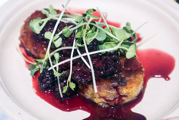Chicken confit served on a green plantain cake and topped with blackberry bourbon gastrique and sprouts was one of the offerings by Ramsi's during the FEAST O.F.F. on Saturday. 9/3/16