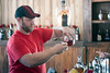 J.D. Hobbs pours a Maker's Mark in the bourbon tent during the Kentucky Bluegrass & Bourbon Experience on Saturday. 9/3/16