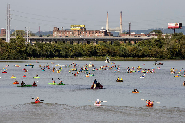 Paddlers head west down the Ohio River on Monday morning during the Mayor's Hike, Bike and Paddle. 9/5/16