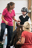 Jane Harper helps Noah Renner saddle up for a hippotherapy session at Green Hill Therapy. 9/8/16