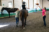 Jane Harper tosses a football to Noah Renner as part of a routine in the hippotherapy offered at Green Hill. 9/8/16