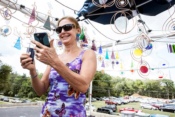 Artist Dru Perry rings up another sale in her Dru Designs booth during the September Art Fair at Mellwood on Saturday. 9/10/16