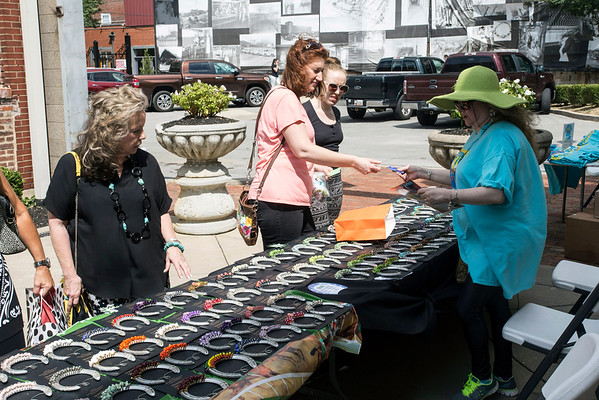 Scooter Davidson mans her booth during the September Art Fair on Saturday afternoon. 9/10/16