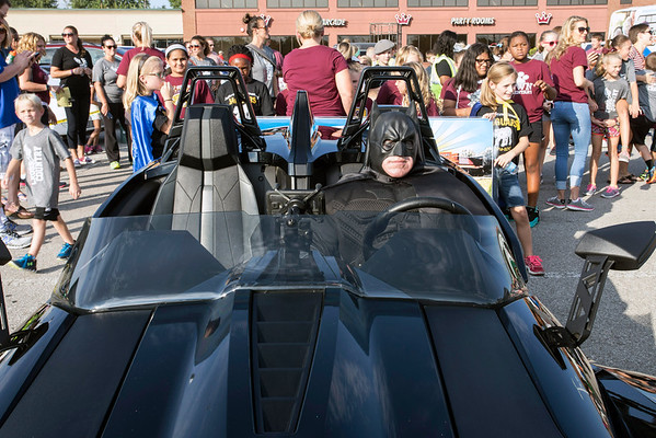 Billy Elder, costumed as Batman, prepares to lead a group of J-town Elementary students in the Gaslight Festival Parade on Thursday afternoon. 9/15/16
