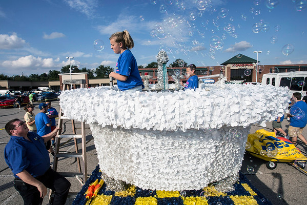 Gigi Day receives instruction from Bill Stout of Maeser Plumbing on how to work the bubble machine in the bathtub float the company has entered into the Gaslight Festival Parade for the past fifteen years. 9/15/16