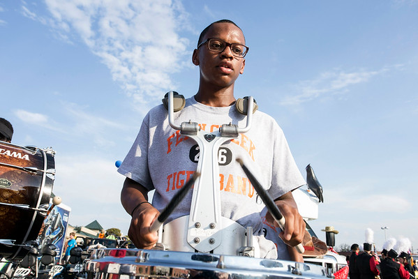 Fern Creek marching band drummer Royce Brittentime gets warmed up before embarking on the Gaslight Festival Parade route. 9/15/16