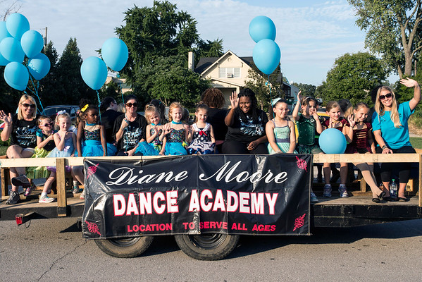 Miniature dancers from the Diane Moore Academy wave to the crowd during the Gaslight Festival Parade on Thursday. 9/15/16