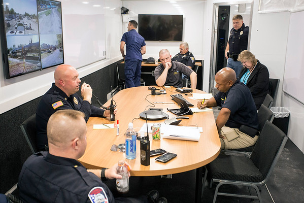 Lead officers organize a training exercise at a CSX rail yard from a command center near the mock hazardous material spill site. 9/20/16