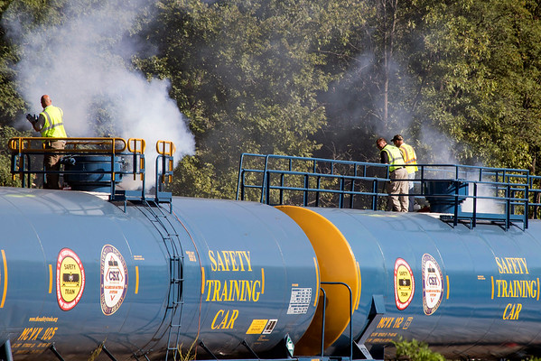 Smoke rises above the CSX saftey training cars as first responders in Jeffersonville take part in an exercise to familiarize themselves with rail road incidents. 9/20/16