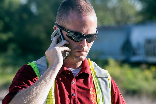 Jeremy Kremer, director of transportation for the Louisville and Indiana Railroad, makes an actual 911 call to trigger the response to a mock hazardous material spill during a training exercise in Jeffersonville on Tuesday morning. 9/20/16