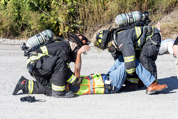 A CSX employee is evacuated from a spill site by first responders during a training exercise in Jeffersonville on Tuesday morning. 9/20/16