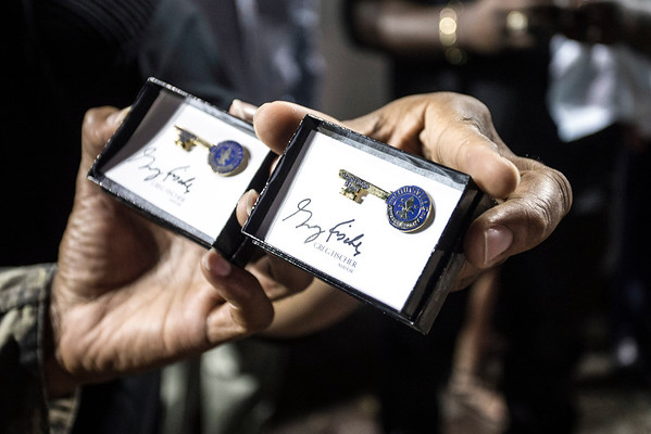 Members of Linkin' Bridge show off the keys to the city they received from Louisville mayor Greg Fischer on Saturday night at Churchill Downs. 9/24/16
