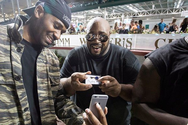 Ekoe Alexanda and Montre Davis of Linkin' Bridge compose a cellphone shot of the key to the city pins they received from Louisville mayor Greg Fischer on Saturday night at Churchill Downs. 9/24/16