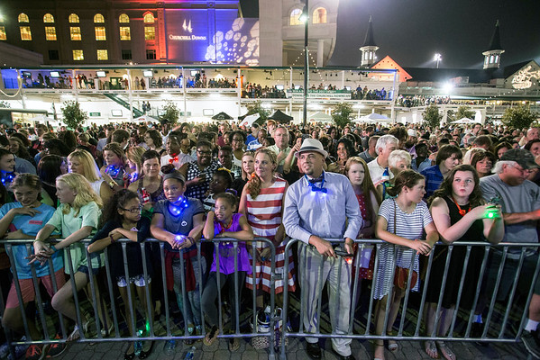 A crowd in the hundreds gathered around a stage at Churchill Downs on Saturday night to see a performance by America's Got Talent runner-up's Linkin' Bridge. 9/24/16