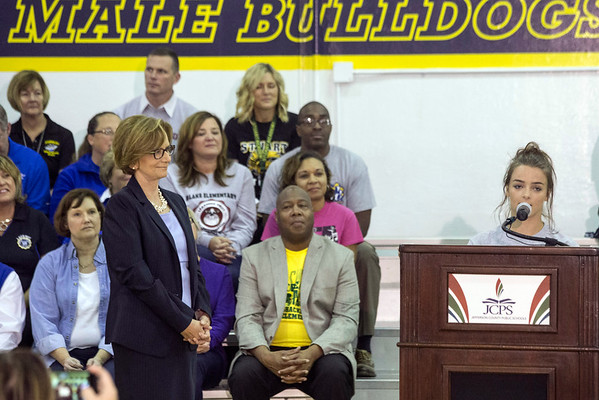 JCPS superintendent Donna Hargens listens as Fairdale High senior Cassidy Jenkins speaks during a Thursday morning rally about the improvements at her school. 9/29/16