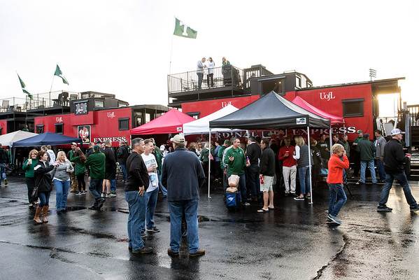 Trinity and St. X fans gather near the cabooses at Papa John's Stadium before the classic rivalry game on Friday night. 9/30/16