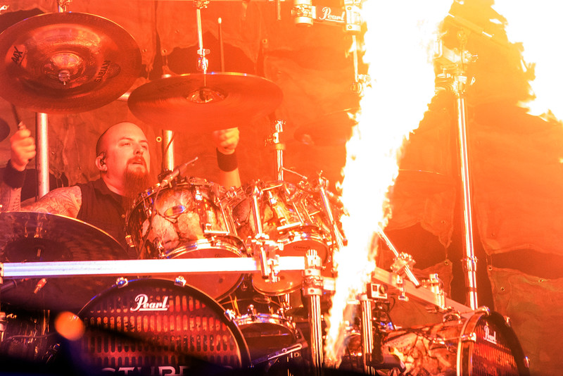 Drummer Mike Wengren of Disturbed plays along with fire bursts at Louder Than Life. 10/2/16