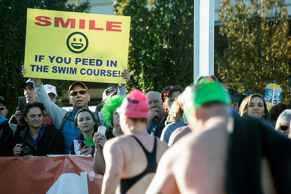 Humorous signs were hoisted high along the Ironman route to encourage the participants. 10/9/16