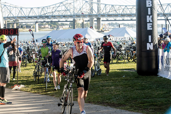 Ironman participants ready themselves for the 112-mile course after completing a 2.4 mile swim on Sunday. 10/9/16