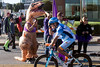 A t-rex cheers on bikers at the start of the 112-mile course of the 2016 Ironman on Sunday. 10/9/16