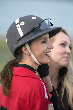 Polo player Tiffany Meredith chats with friends before an exhibition match at Waterfont Park on Thursday night. 10/13/16