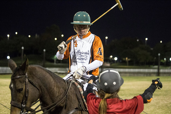 Polo player Brent Boland receives pre-match instruction during an exhibition on Thursday night at Waterfront Park. 10/13/16