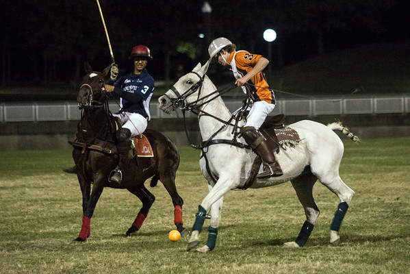 Teenage polo player James Boland moves in on the ball during an exhibition match at Waterfront Park on Thursday night. 10/13/16
